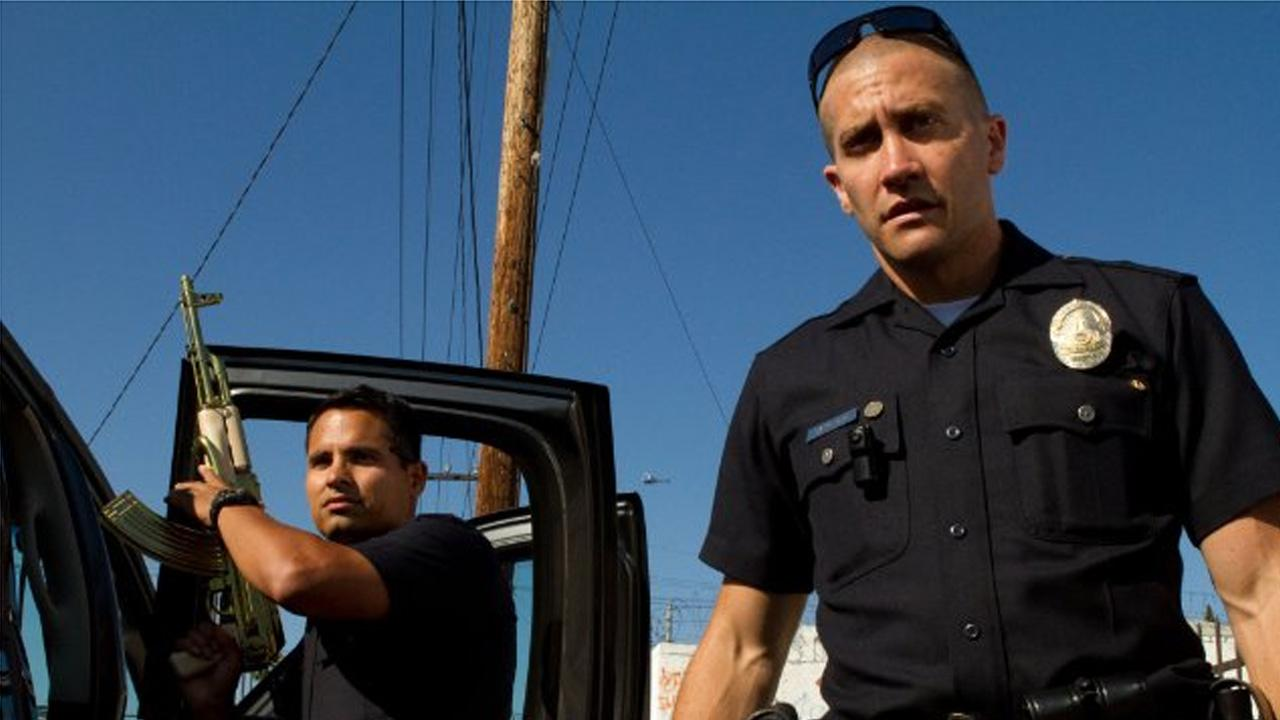Jake Gyllenhaal (right) and Michael Pena appear in a scene from the 2012 film End of Watch.