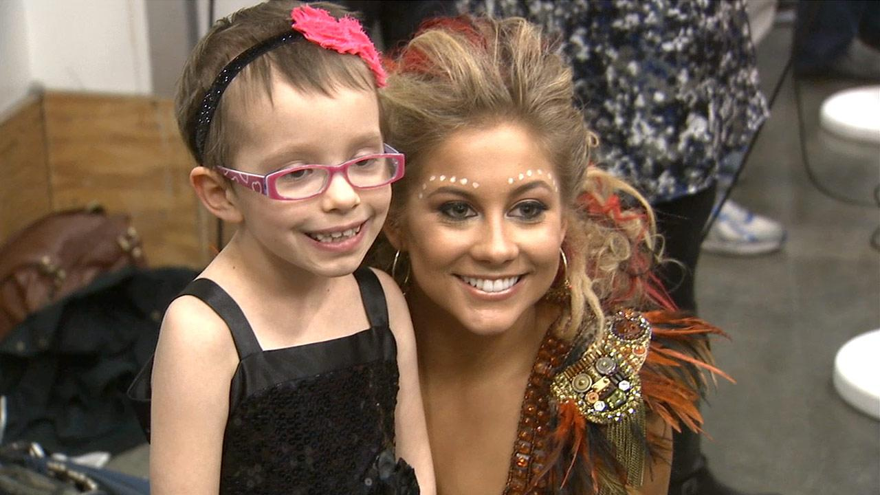 Tori Scott (left) takes a picture with Dancing With The Stars contestant Shawn Johnson in this photo from November 2012. The 7 year old, who has spent most of her life dealing with the rare genetic disorder neurofibromatosis, is a big fan of the show.