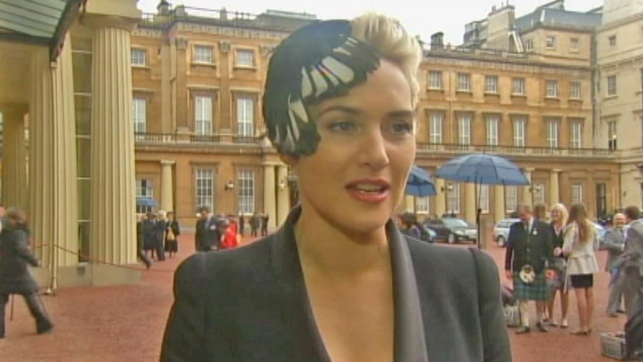 Actress Kate Winslet speaks with media after being given the title of CBE, which stands for Commander of the British Empire.