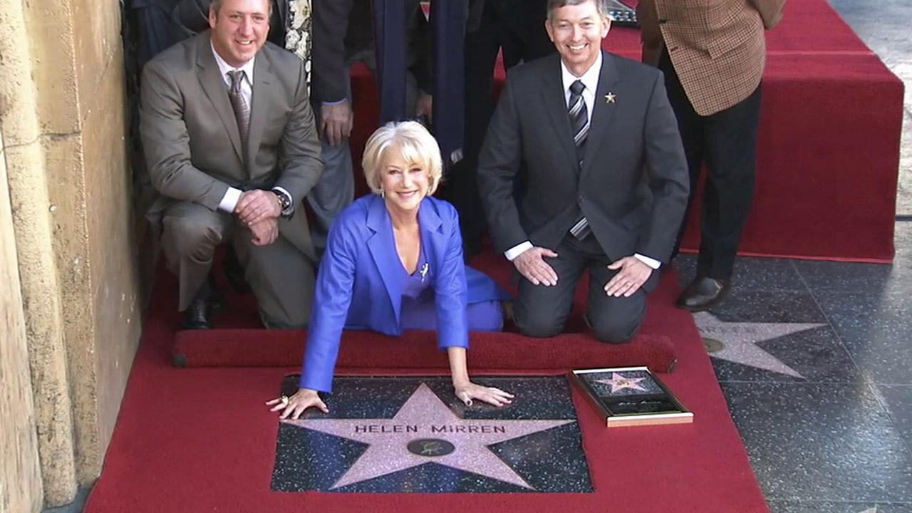 Actress Helen Mirren poses at a ceremony honoring her star on the Hollywood Walk of Fame on Thursday, Jan. 3, 2012.