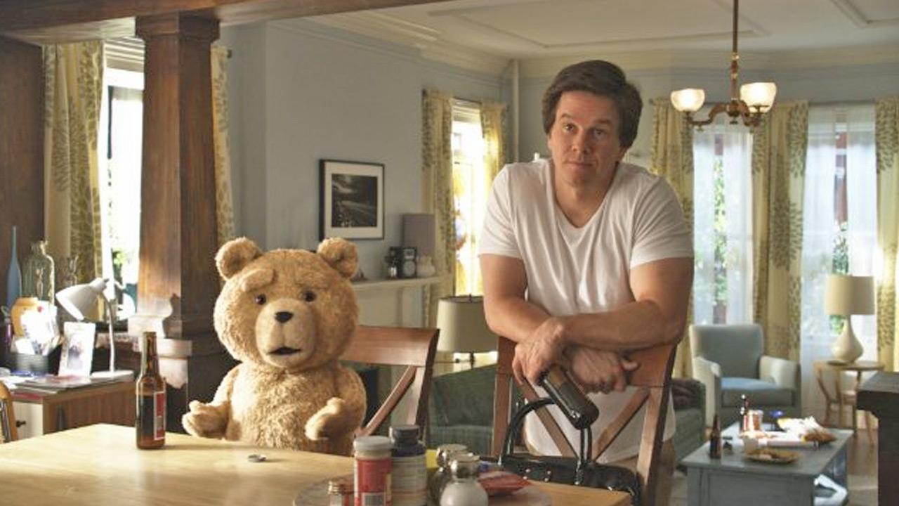 Mark Wahlberg and Ted are shown in a still image from the film, Ted.