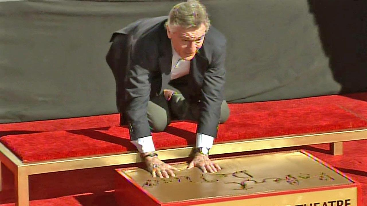 Robert De Niro is seen placing his handprints in cement at the TCL Chinese Theatre on Monday, Feb. 4, 2013.