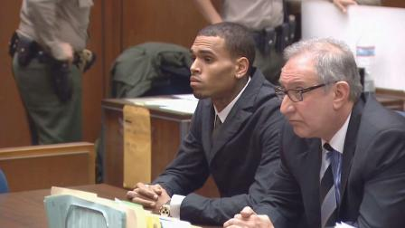Singer Chris Brown was in court Wednesday, Feb. 6, 2013, to face  questions over whether he violated his probation by failing to perform his community labor sentence for Rihannas 2009 beating.