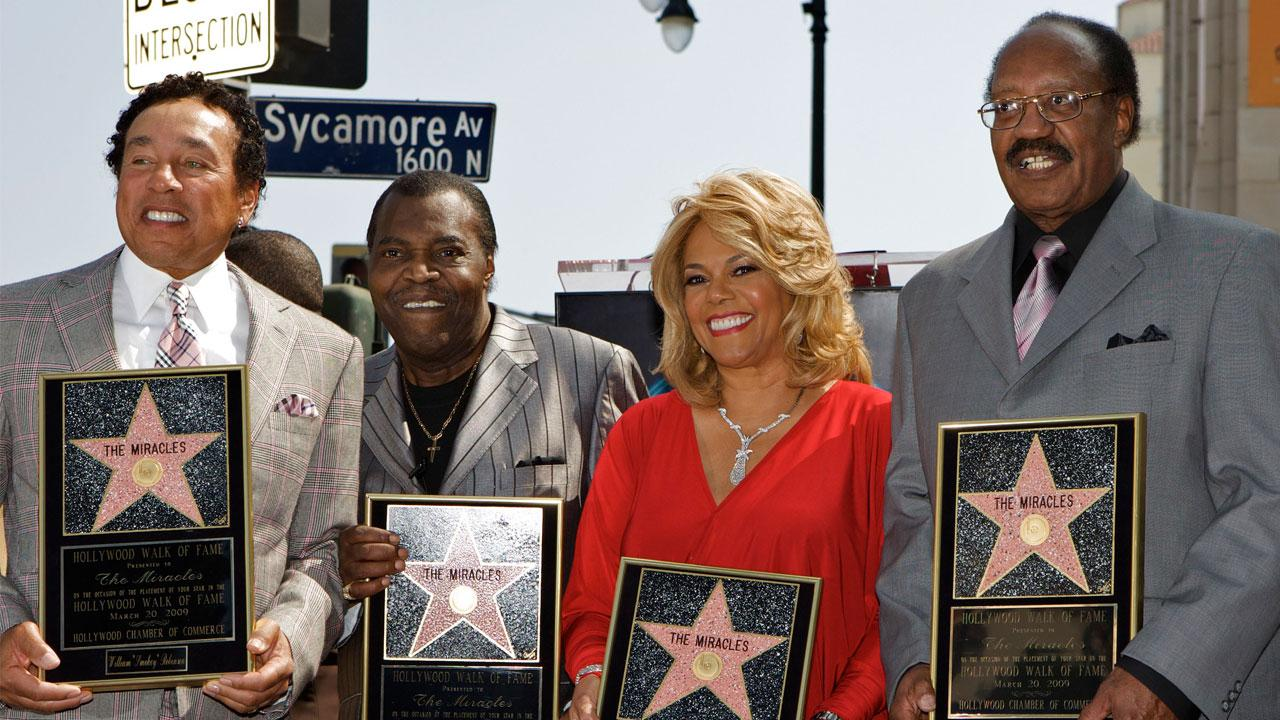 In this March 20, 2009 file photo, members of the Motown group The Miracles, from left: William Smokey Robinson, Warren Pete Moore, Claudette Robinson, and Robert Bobby Rogers, are honored with a star on the Hollywood Walk of Fame in Los Angeles. <span class=meta>(Damian Dovarganes)</span>