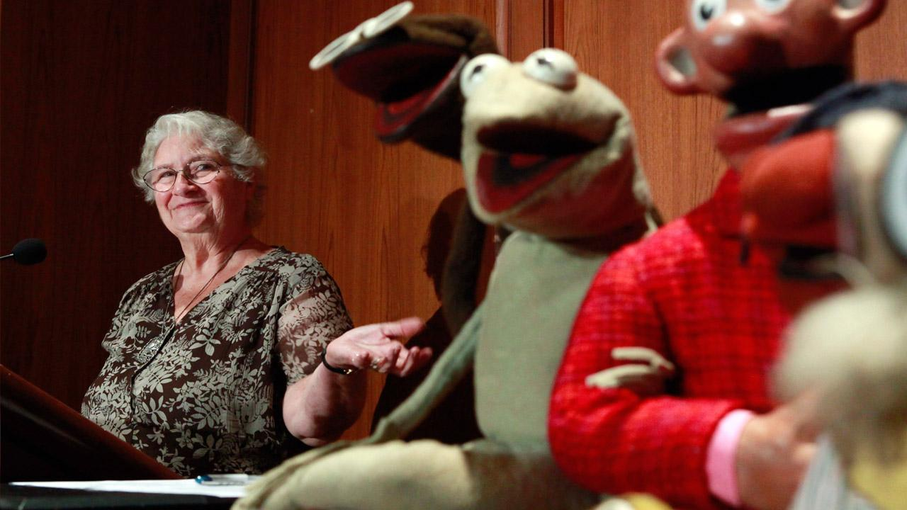 FILE- in this Wed., Aug. 25, 2010 photo, Jane Henson, left, donates some of Jim Hensons early puppets, including the original Kermit, to the Smithsonian Institution, during a ceremony at the National Museum of American History, in Washington.AP Photo/Jacquelyn Martin, File