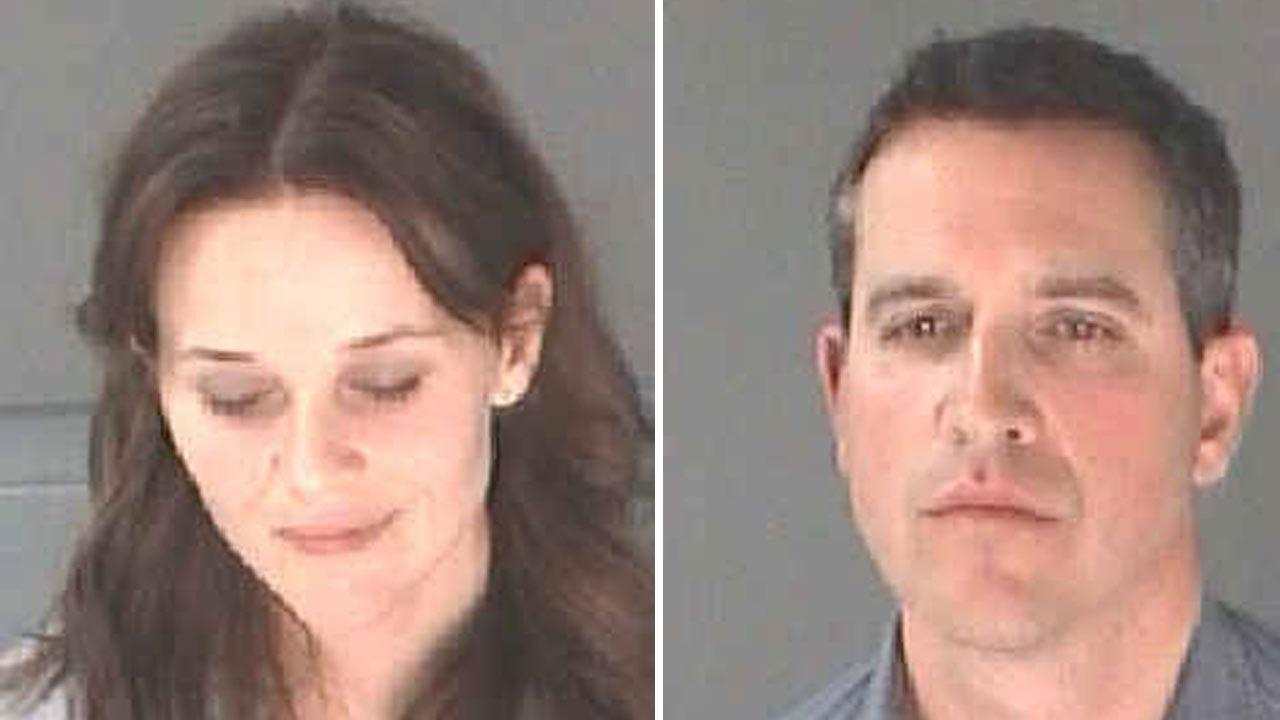 Authorities released this photo of actress Reese Witherspoon (left) and her husband, Jim Toth, after she was arrested for disorderly conduct while her husband was arrested for DUI on Friday, April 19, 2013.