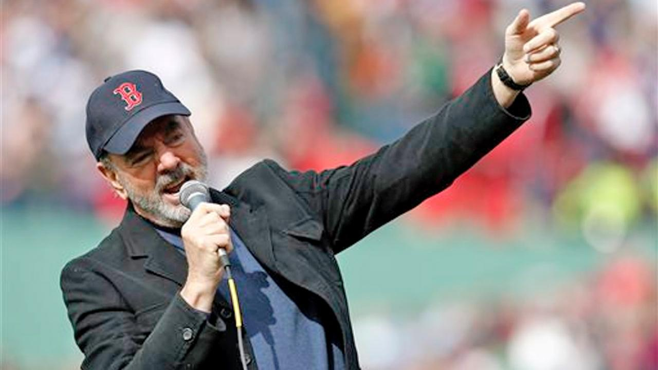 Neil Diamond sings Sweet Caroline during the eighth inning of a baseball game between the Boston Red Sox and the Kansas City Royals in Boston, Saturday, April 20, 2013.
