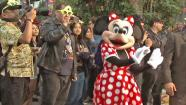 A crowd gathers around Minnie Mouse during Disneylands 24-hour celebration Friday, May 24, 2013.