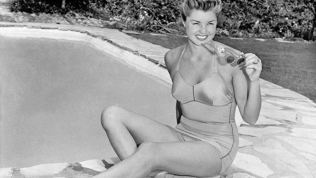 Actress and former national swimming champion Esther Williams is shown poolside at her home in Hollywood, June 10, 1948. Williams died on Thursday, June 6, 2013 in her sleep, according to her longtime publicist Harlan Boll.