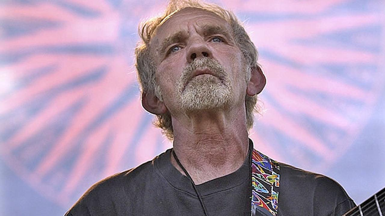 In this June 5, 2004 file photo, singer-songwriter J.J. Cale plays during the Eric Clapton Crossroads Guitar Festival in Dallas, Texas.Tony Gutierrez