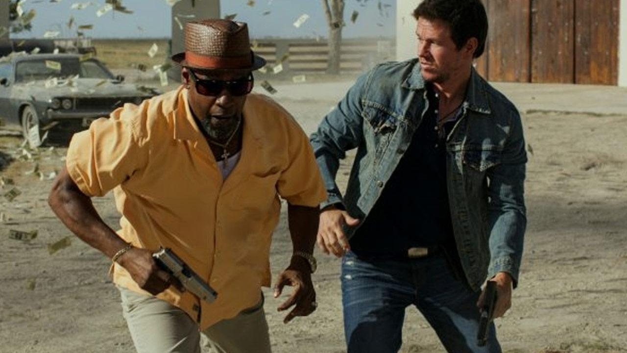 Mark Wahlberg and Denzel Washington appear in a scene from the 2013 film, 2 Guns.