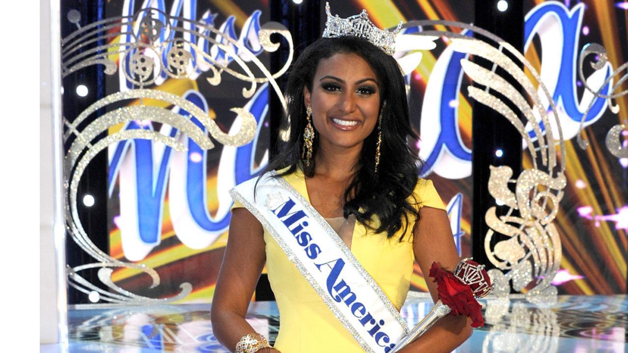 Miss New York Nina Davuluri walks down the runway after winning the Miss America 2014 pageant, Sunday, Sept. 15, 2013, in Atlantic City, N.J.
