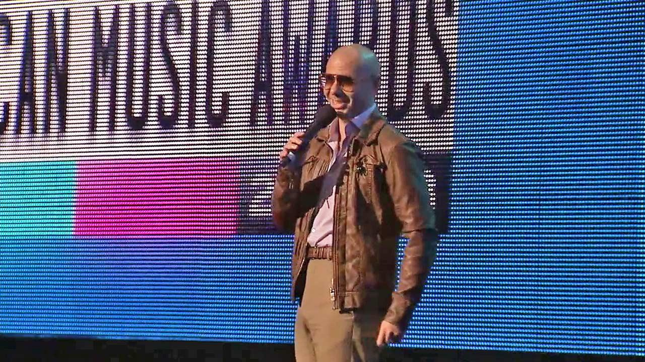 Pitbull rehearses his hosting duties for the American Music Awards.