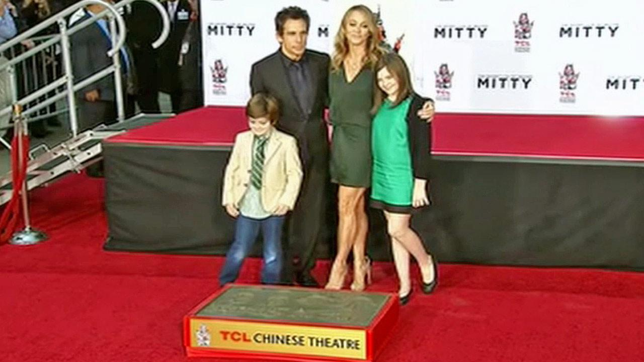 Ben Stiller, his wife Christine Taylor and their two children pose in front of Stillers hand and footprints, which the actor imprinted in front of the TCL Chinese Theatre in Hollywood on Tuesday, Dec. 3, 2013.