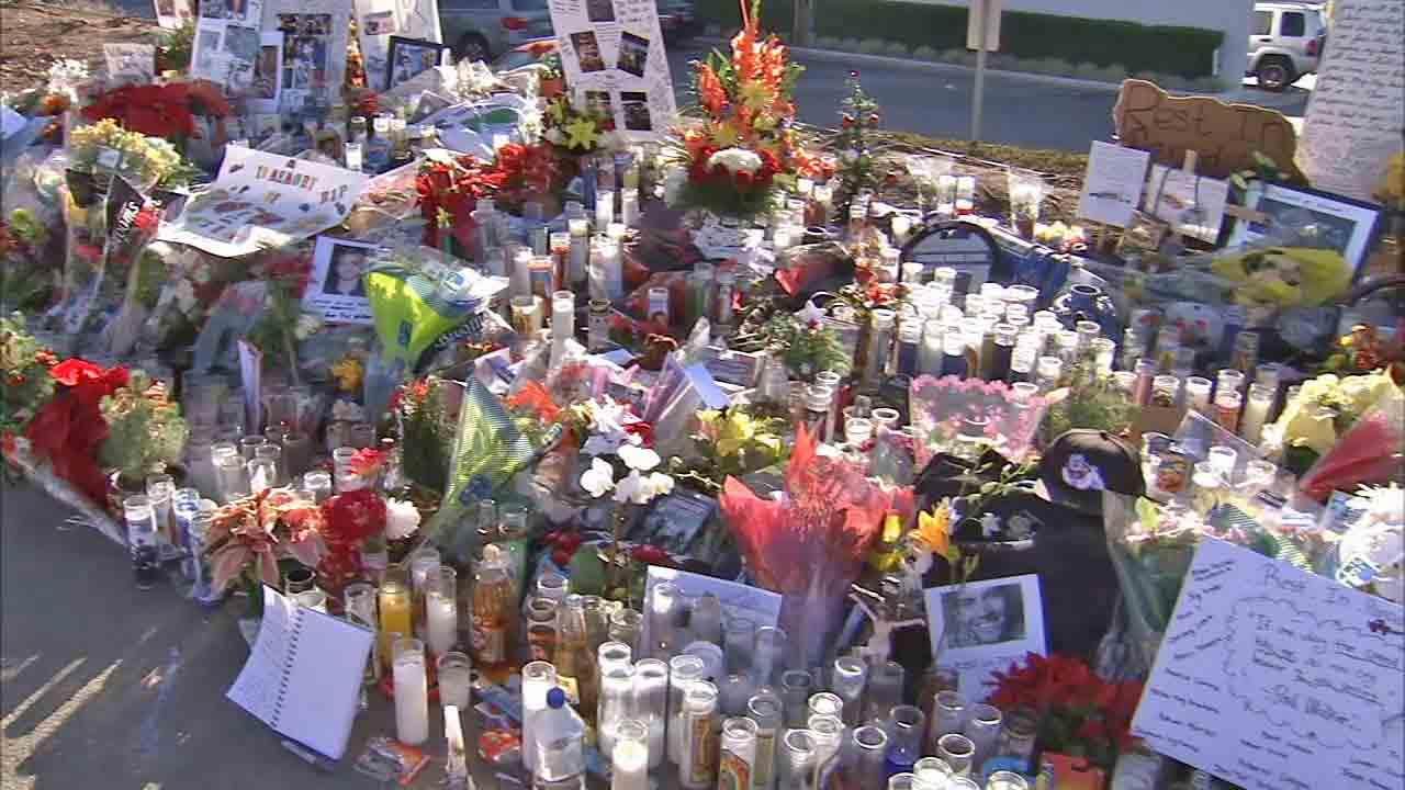 Flowers and candles are seen at the crash site that claimed the life of Paul Walker and his friend, Roger Rodas, during a memorial rally and car cruise in Santa Clarita on Sunday, Dec. 8, 2013.