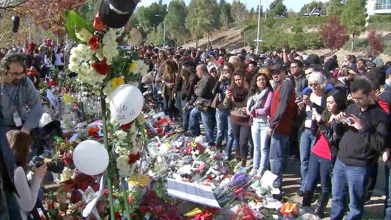 Thousands of fans gathered at the crash site that claimed the life of Paul Walker and his friend, Roger Rodas, for a memorial rally and car cruise in Santa Clarita on Sunday, Dec. 8, 2013.