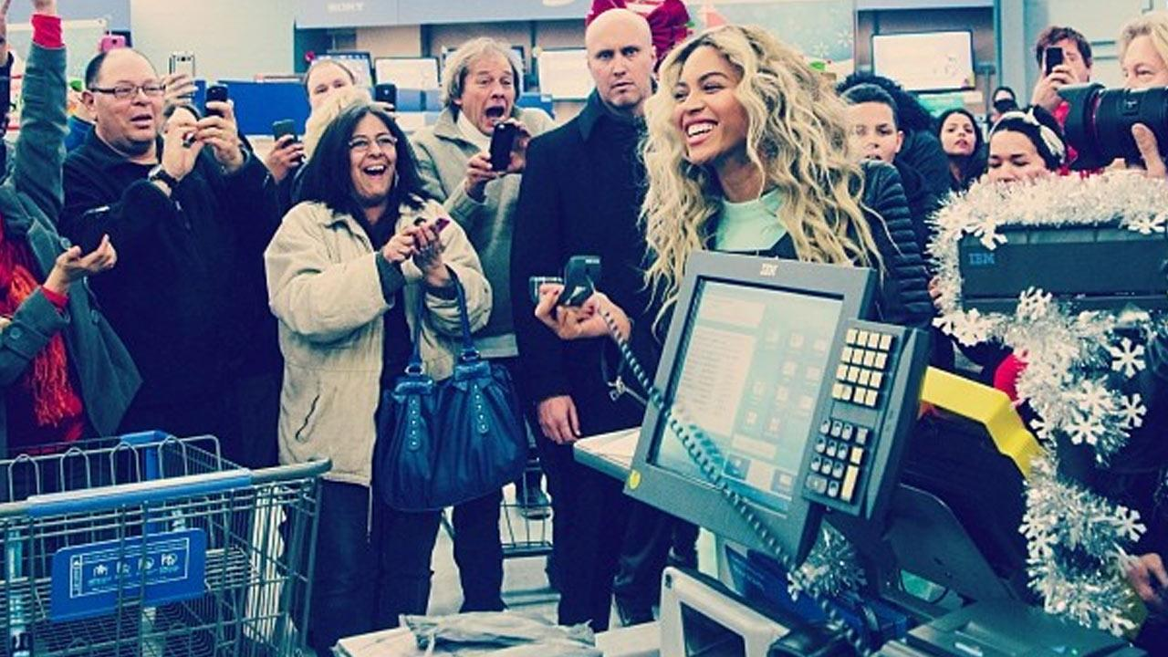 Beyonce is shown in a photo posted on her official Instagram accouint at a Massachusetts Wal-Mart, where she surprised fans on Friday, Dec. 20, 2013.