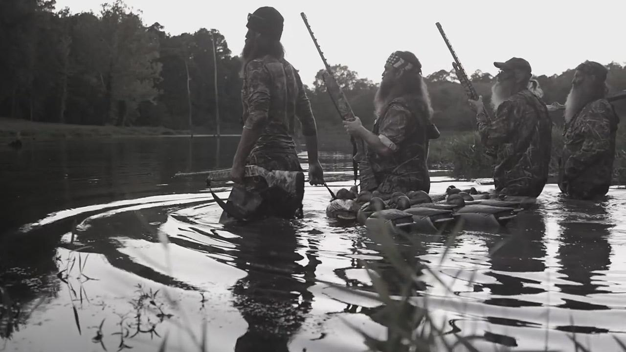 Cast members of Duck Dynasty are shown holding their own line of guns in a still image from a commercial with gun-maker Mossberg.