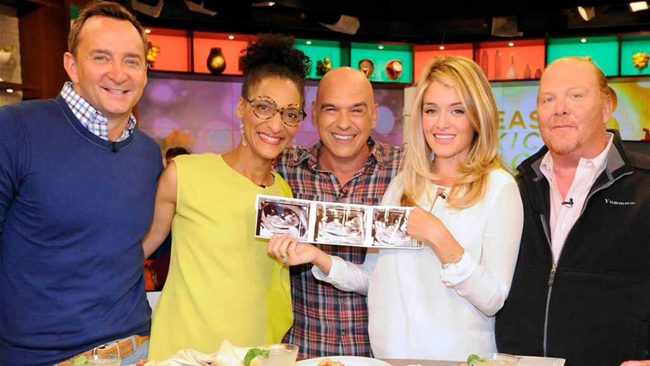 (Left to right) The Chew hosts Clinton Kelly, Carla Hall, Michael Symon, Daphne Oz and Mario Batali pose with Ozs sonogram photos in this September photo.