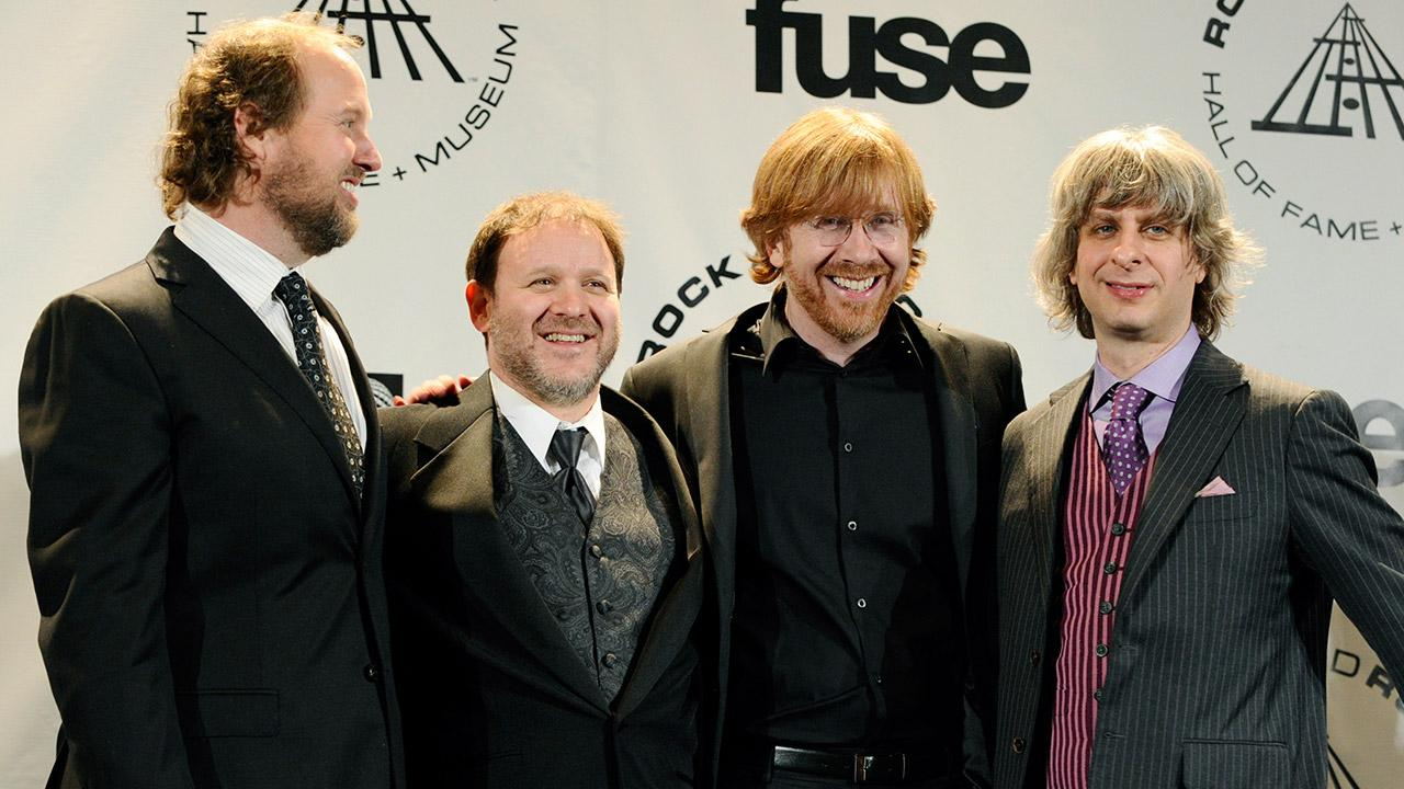 #25 on the Billboard.com list of highest-paid musicians: Phish, who earned $12,406,611.95 in 2013. <span class=meta>(Peter Kramer)</span>