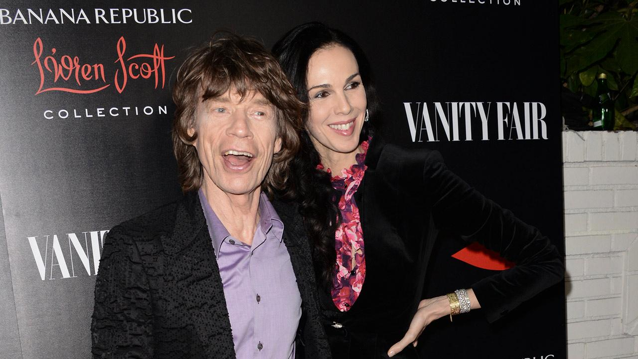 In a Tuesday, Nov. 19, 2013 file photo, singer Mick Jagger, left, and fashion designer LWren Scott arrive at the Banana Republic LWren Scott Collection launch party at the Chateau Marmont, in West Hollywood, Calif. <span class=meta>(Dan Steinberg&#47;Invision)</span>