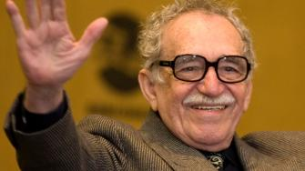 Colombian writer Gabriel Garcia Marquez wave to fans during the International Book Fair in Guadalajara, Mexico, Sunday, Nov. 25, 2007.