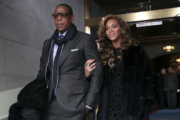 Jay-Z and Beyonce attend the ceremonial swearing-in of President Barack Obama at the U.S. Capitol during the 57th Presidential Inauguration in Washington on Jan. 21, 2013. <span class=meta>(AP Photo &#47; Win McNamee)</span>