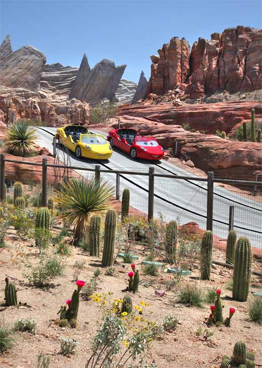 "<div class=""meta image-caption""><div class=""origin-logo origin-image ""><span></span></div><span class=""caption-text"">Cars Land features three immersive family attractions showcasing characters and settings from the Disney-Pixar film, 'Cars,' including one of the largest and most elaborate attractions ever created for a Disney park: Radiator Springs Racers, shown here during testing, is a twisting turning, high-speed adventure through Ornament Valley and the town of Radiator Springs. (Paul Hiffmeyer/Disneyland Resort)</span></div>"