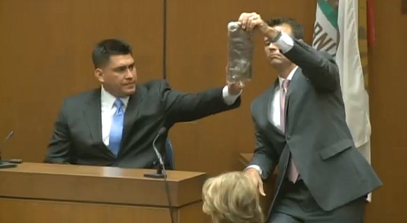 Deputy District Attorney David Walgren holds up a saline bag at Conrad Murray&#39;s involuntary manslaughter trial in Los Angeles on Thursday, September 29, 2011. Alberto Alvarez, Michael Jackson&#39;s former bodyguard, appears near him. He confirmed a 100 ml bottle of propofol was contained inside the saline bag at the scene where he found the singer hours before he was pronounced dead. He said Murray told him to stash the saline bag in another bag, before he instructed him to call 911. <span class=meta>(KABC)</span>
