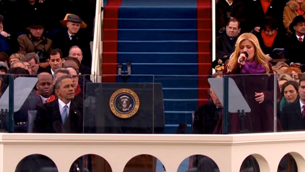 "<div class=""meta image-caption""><div class=""origin-logo origin-image ""><span></span></div><span class=""caption-text"">Kelly Clarkson performs 'My Country 'Tis of Thee' at President Barack Obama's ceremonial swearing-in ceremony during the 57th Presidential Inauguration. (KABC-TV)</span></div>"