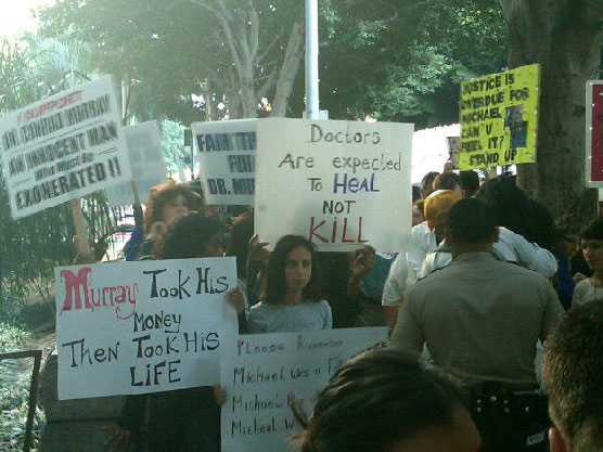 Sept. 27, 2011: Protesters stand outside the Los Angeles courthouse where Conrad Murray is on trial for involuntary manslaughter following the 2009 death of Michael Jackson.