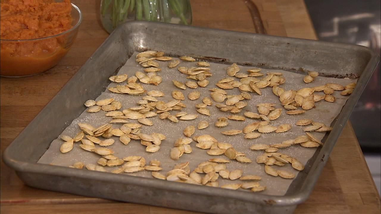 Save the pumpkin seeds for a sensational snack. Just separate the seeds from the flesh and then put them on an oiled sheet pan. Sprinkle a little salt on it and put it in the oven at about 350 degrees for about 10 to 12 minutes.