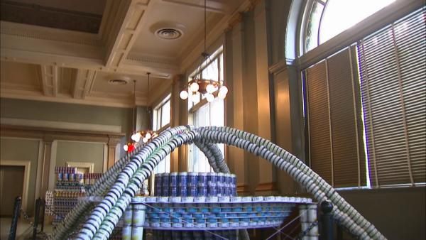 Canned goods turned into art for good cause