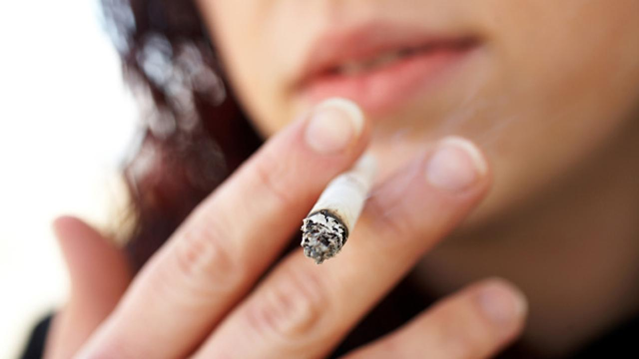 A woman is seen smoking in this file photo.
