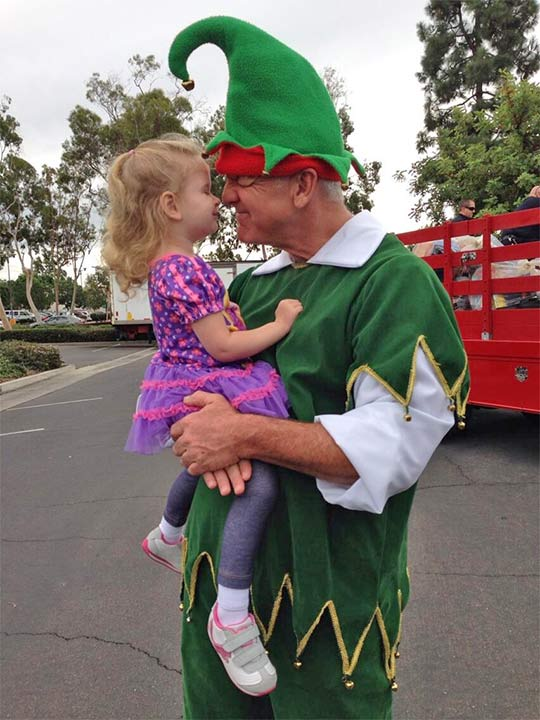 Garth the Elf and a little girl are shown at our Stuff-A-Bus event at Los Cerritos Center in Cerritos on Friday, Nov. 22, 2013.