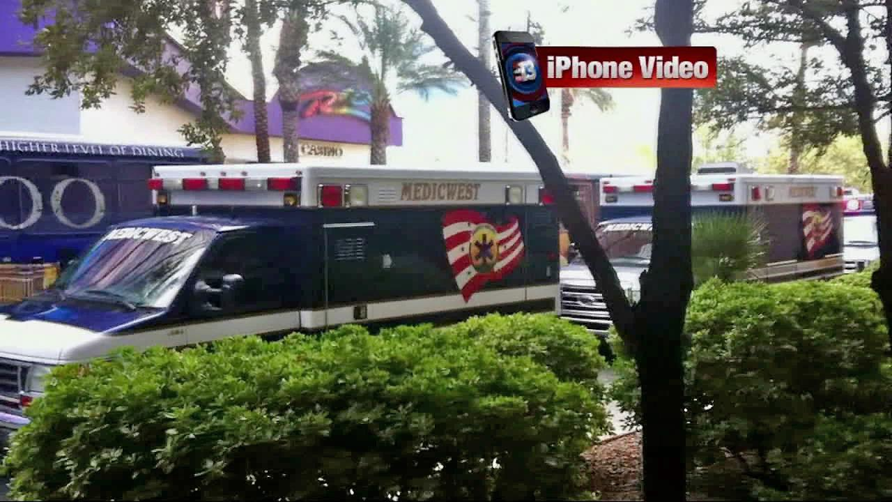 Ambulances are seen outside the Rio Hotel and Casino in Las Vegas on Friday, Nov. 29, 2013, after a group of young football players were sickened.