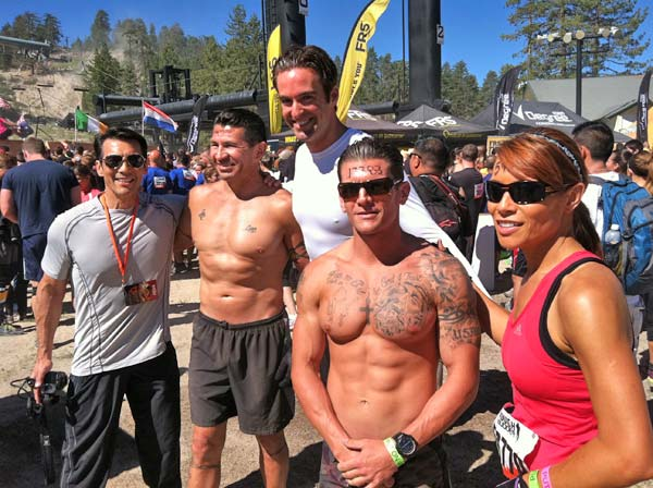 "<div class=""meta ""><span class=""caption-text "">From left to right, ABC7's David Ono, Santa Ana Police Cpl. Ed Hernandez, reporter Elex Michaelson, Santa Ana Police Officer Pete Picone and reporter Eileen Frere pause to take a photo at the Tough Mudder event in Running Springs, on Saturday, July 7, 2012. (KABC Photo)</span></div>"