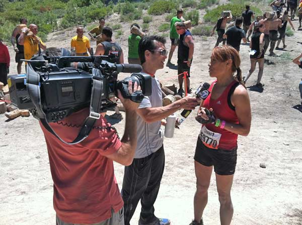 ABC7's David Ono interviews reporter Eileen Frere during the Tough Mudder event in Running Springs on Saturday, July 7, 2012.