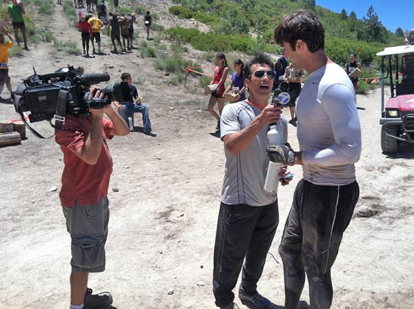 ABC7's David Ono interviews reporter Elex Michaelson during the Tough Mudder event in Running Springs on Saturday, July 7, 2012.