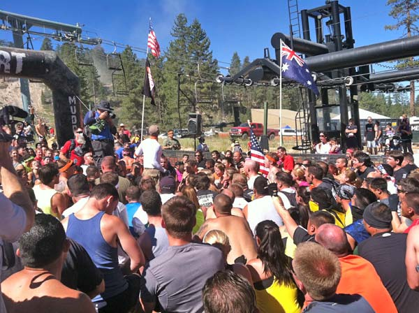 Tough Mudder participants take a knee prior to the start of the event on Saturday, July 7, 2012. <span class=meta>(KABC Photo)</span>