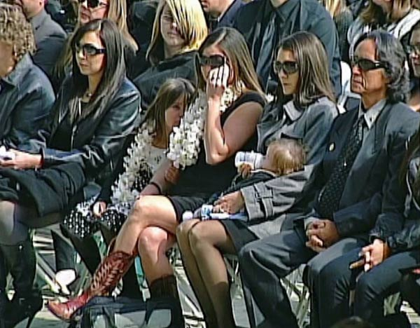 The wife and children of San Bernardino County Sheriff&#39;s Detective Jeremiah MacKay are seen at his funeral service on Thursday, Feb. 21, 2013. The 35-year-old was the last person allegedly killed by Chris Dorner in a shootout at an Angelus Oaks mountain cabin on Tuesday, Feb. 12. <span class=meta>(KABC)</span>