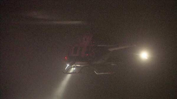 A helicopter flies above the scene of a fatal off-road racing accident where a truck lost control and plowed into a crowd of spectators in Lucerne Valley, Calif., Saturday Aug. 14, 2010.