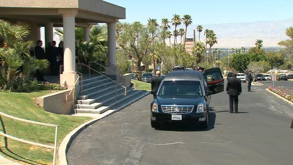A hearse carrying the casket of former first lady Betty Ford arrives at St. Margaret's Episcopal Church in Palm Desert, Calif., Tuesday, July 12, 2011, for funeral services.