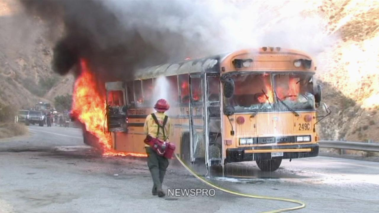 Fire crews respond to a bus fire on Highway 330 in San Bernardino on Saturday, July 8, 2012.