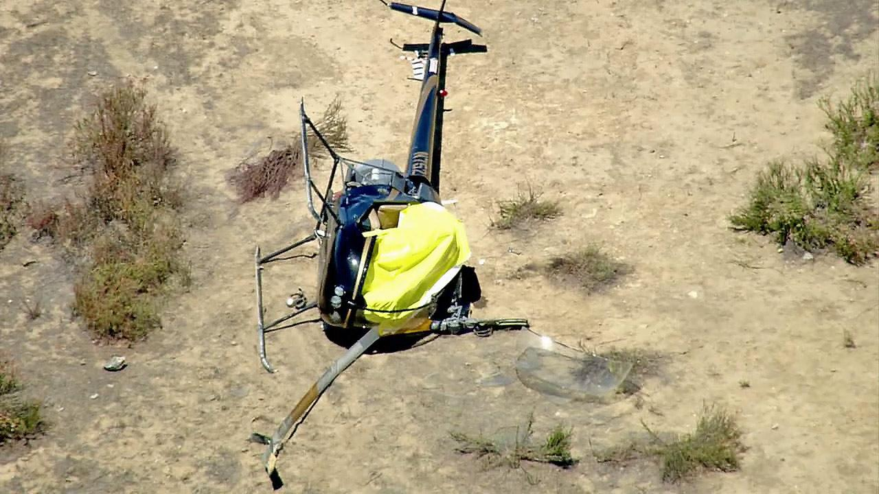 A helicopter is seen following a crash near Lake Skinner on Monday, July 9, 2012. Two people were on board; one died and the other had minor injuries.