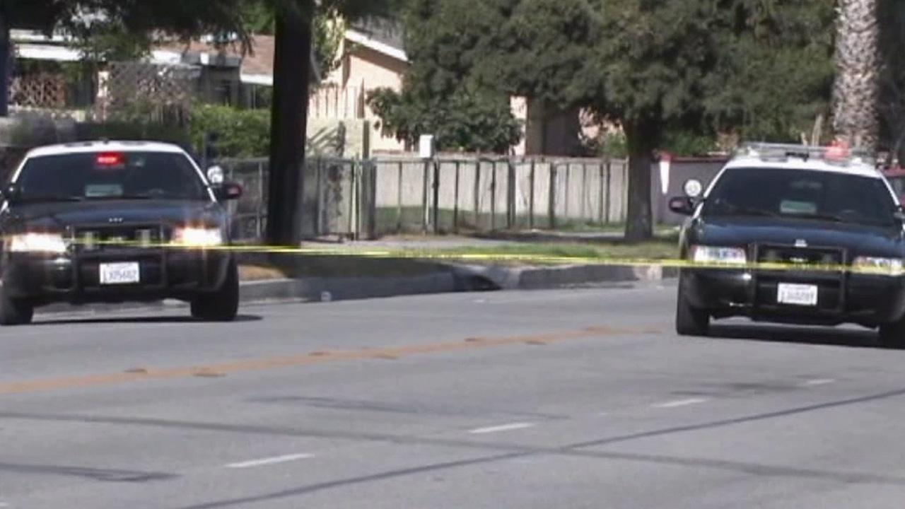 Patrol cars are parked at the scene of a double shooting in San Bernardino on Tuesday, July 10, 2012.