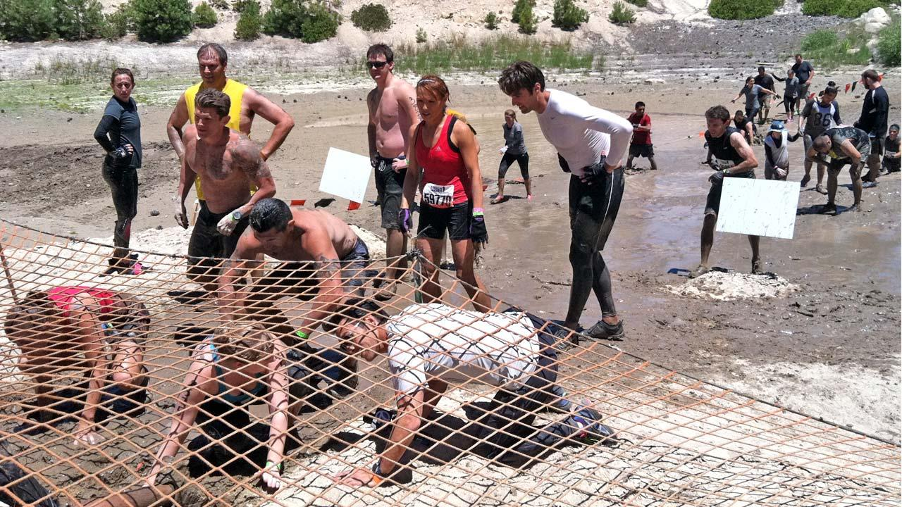 Men and women take part in an obstacle course at Tough Mudder, a grueling 12-mile course held in Running Springs on Saturday, July 7, 2012.