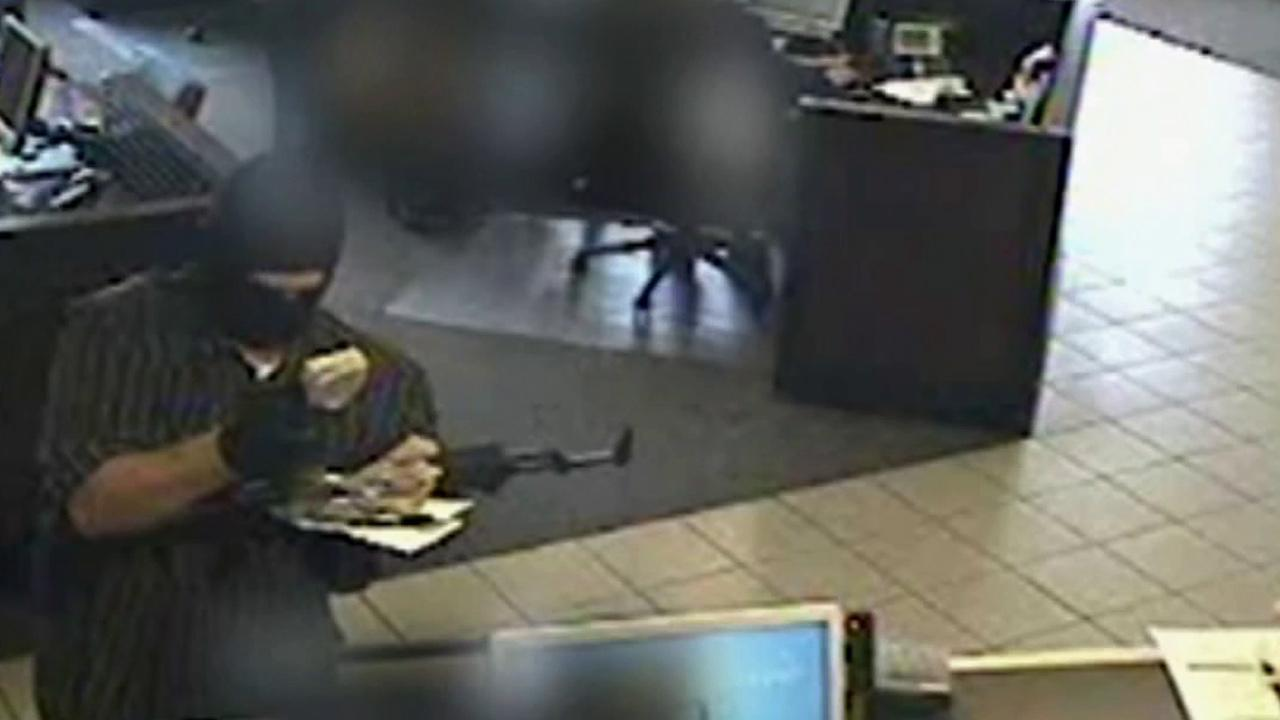 A bank robbery suspect dubbed the AK-47 Bandit is seen in this July 2012 surveillance video from a Washington bank.