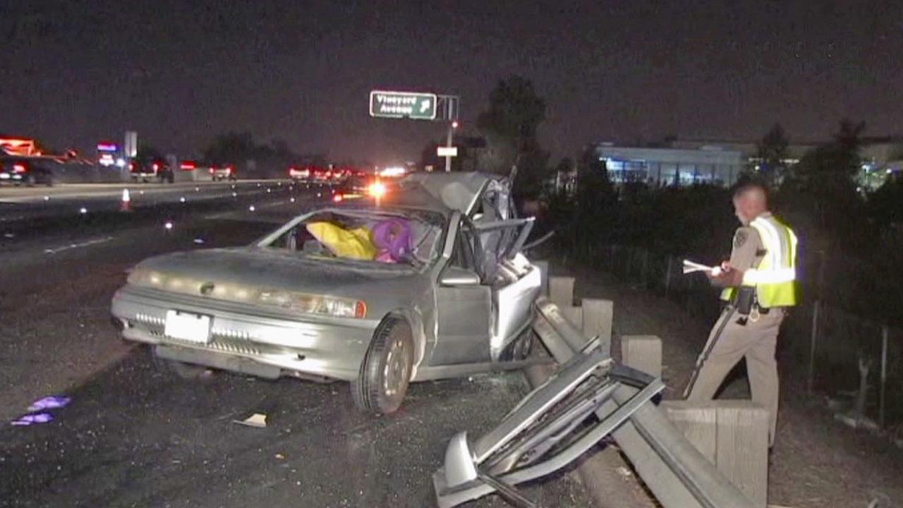 A wrecked car is shown on the shoulder of the 60 Freeway in Ontario following a fatal collision on Saturday, Aug. 4, 2012.