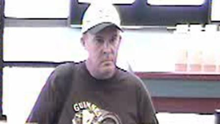 Police released this surveillance photo of a bank robbery suspect who robbed a U.S. Bank in Chino on Wednesday, Aug. 8, 2012.